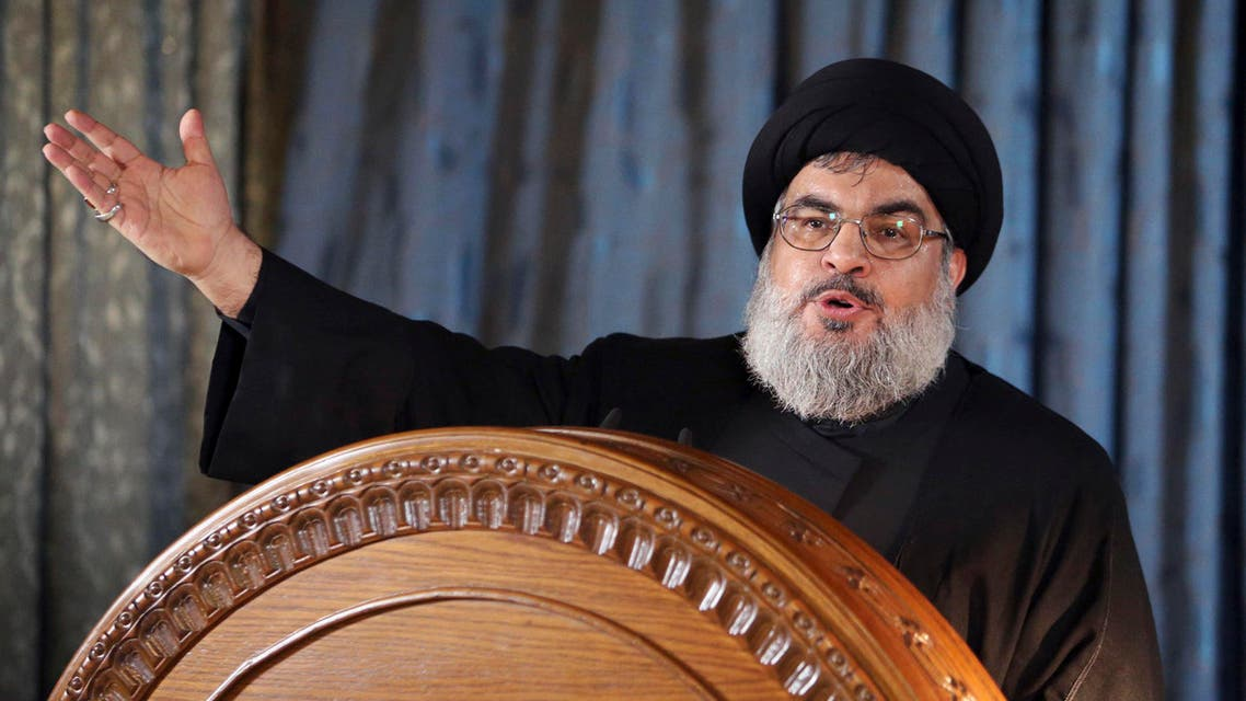Lebanon's Hezbollah leader Hassan Nasrallah gestures as he addresses his supporters in a rare public appearance during a religious ceremony on the eve of Ashura in Beirut's southern suburbs November 13, 2013. (Reuters)