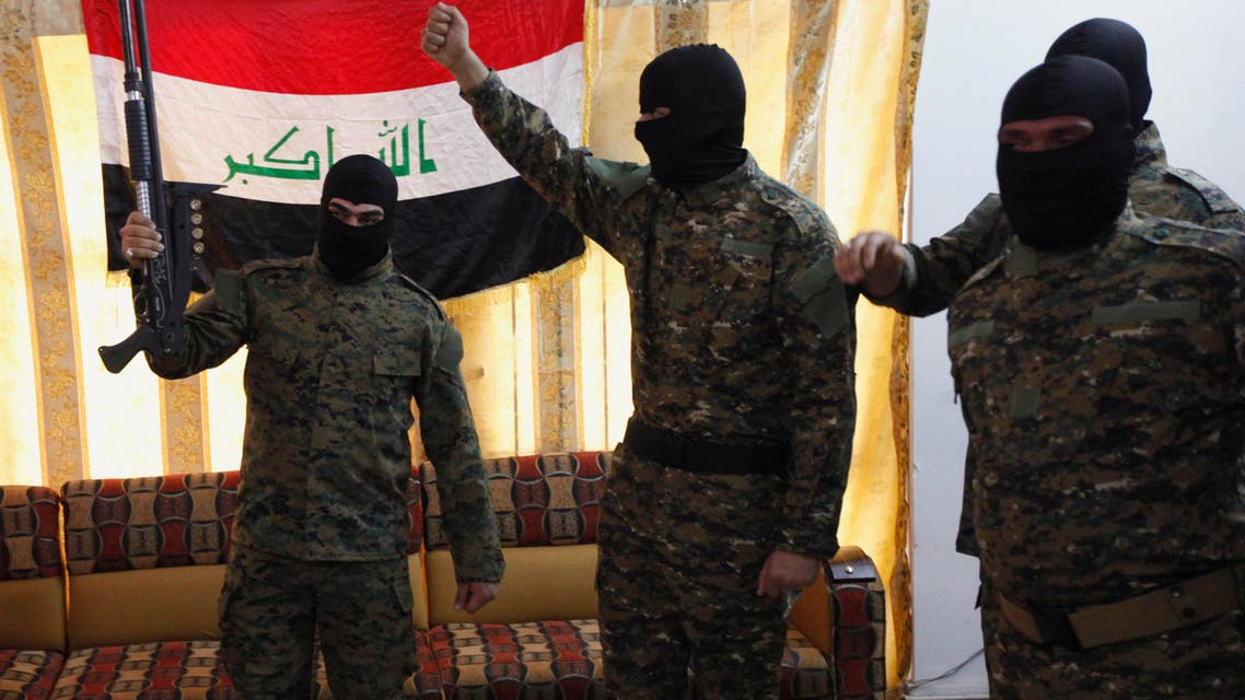Fighters from Iraq's Islamist Shi'ite militias celebrate before departing to Syria from Baghdad, June 11, 2013. (Reuters)