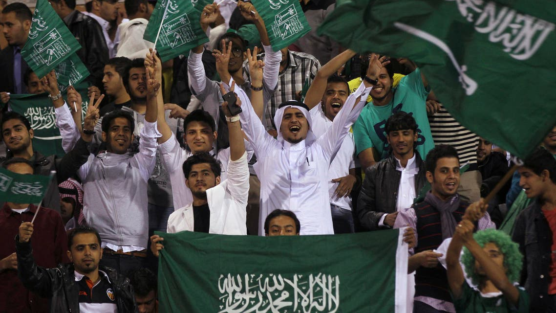 Fans of Saudi Arabia's soccer team cheer during the team's AFC Asian Cup qualifier soccer match against Iraq at the Amman International Stadium in Amman Oct. 15, 2013. (Reuters)