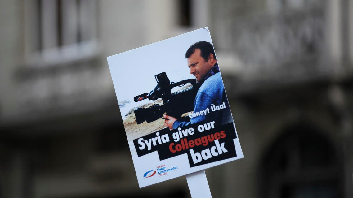 A journalist holds a placard with a picture of Turkish cameraman Cuneyt Unal during a demonstation near the Syrian Consulate in Istanbul Sept. 4, 2012. (Reuters)