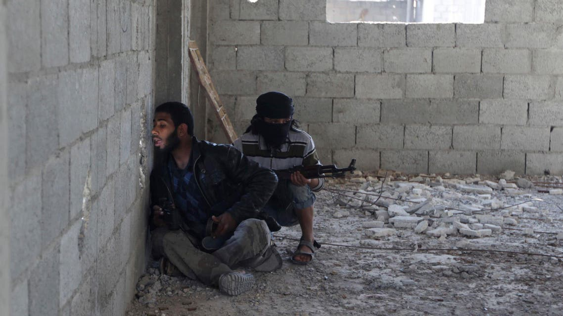 A Free Syrian Army fighter looks through a hole in a wall to find the positions of forces loyal to Syria's President Bashar al-Assad in Deir al-Zor, eastern Syria November 13, 2013. (Reuters)