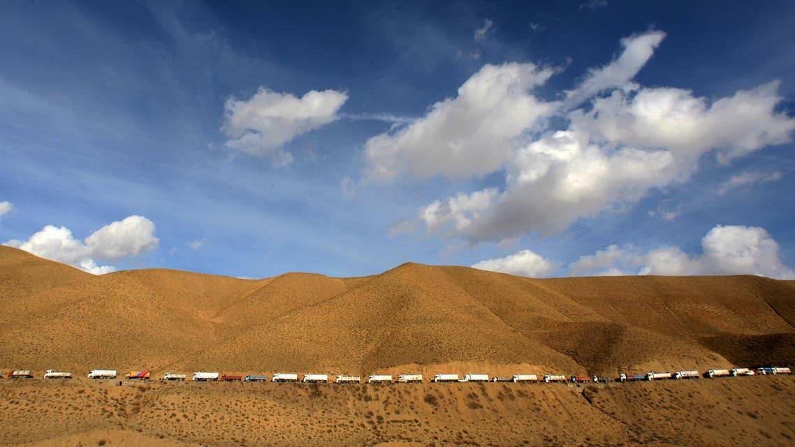 Hundreds of trucks bringing in diesel from Iran line up on a road as they head to the eastern province of Van in Turkey November 30, 2005.  (Reuters)