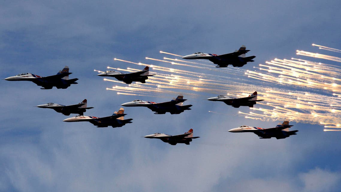 MiG-29 jet fighters from the Strizhi (Swifts) and Sukhoi Su-27 jet fighters from the Russkiye Vityazi (Russian Knights) aerobatic teams fly past during the International Naval Show in St.Petersburg, June 25, 2009. (Reuters)
