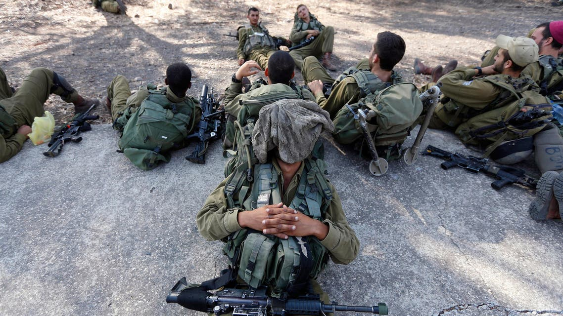 Israeli soldiers rest during a drill in the Israeli-occupied Golan Heights Aug. 28, 2013. (Reuters)