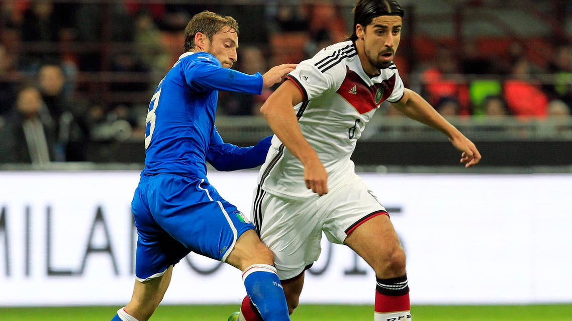 Germany's Sami Khedira reacts after being injured during their international friendly soccer match against Italy at the San Siro Stadium in Milan November 15, 2013.  reuters