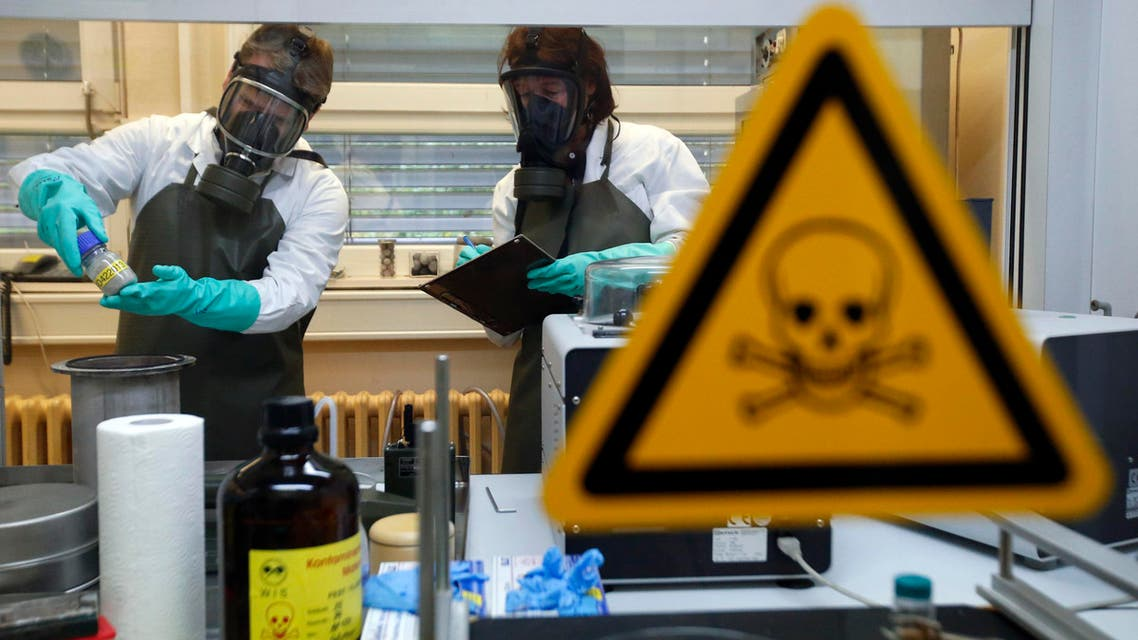 Employees of the Research Institute for Protective Technologies, Nuclear, Biological and Chemical Protection (WIS) inspect a dummy sample which is contaminated with a substance similar to the chemical weapon Sarin reuters