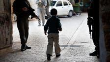 Israeli troops seen 'cuffing Palestinian children'