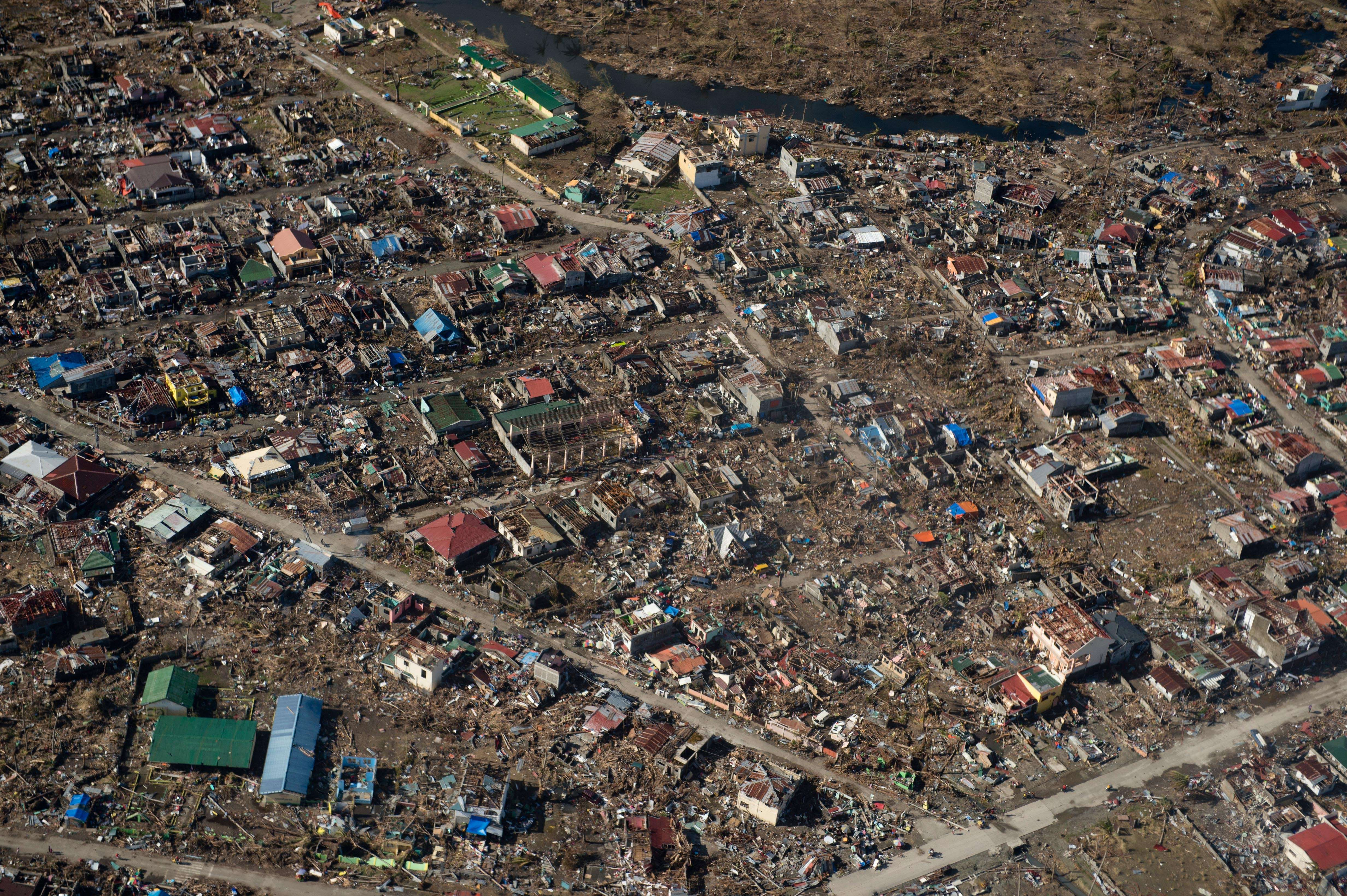 An aerial photo shows destruction from Super Typhoon Haiyan in Tacloban on Nov.16, 2013. (AFP)