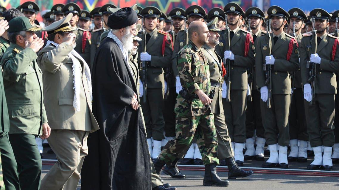 Iran's Supreme Leader Ayatollah Ali Khamenei (L centre) reviews an honor guard during the Iranian army land force academy graduating ceremony in Tehran November 10, 2011.