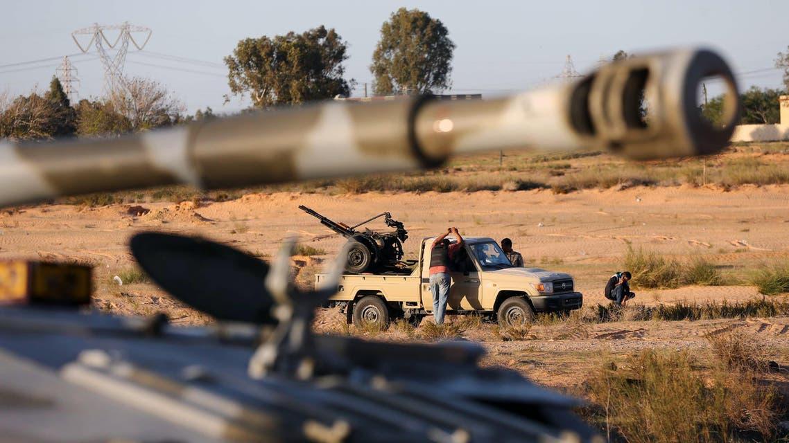 Members of the Tripoli Rebels Brigade militia patrol a main road in Tajura, 15 kms from the capital Tripoli, on November 16, 2013, afp