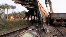 Egypt train crashes into mini-bus, kills 26