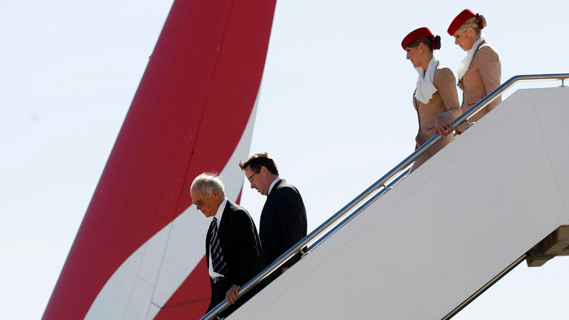 Qantas Chief Executive Officer Alan Joyce (2nd L) and Emirates President Tim Clark (L) descend from an Emirates A380