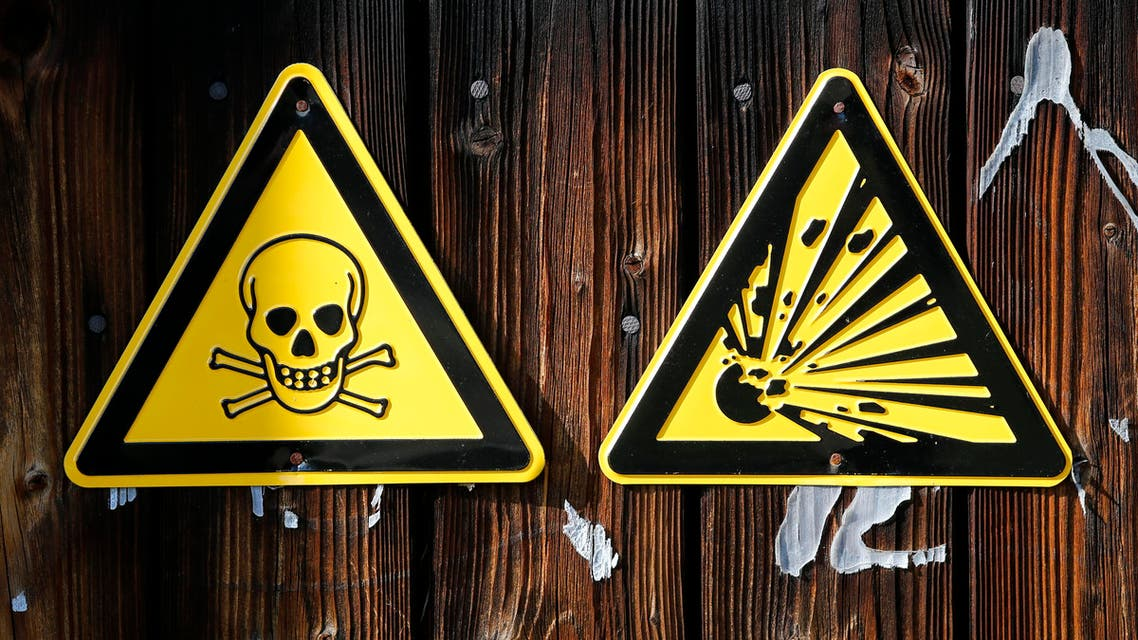 Warning signs hang on a wall at chemical weapons destruction site at the Society for the Disposal of Chemical Weapons and Ordnance (GEKA) in Munster October 14, 2013. reuters