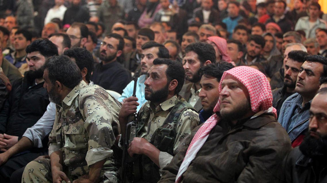 Residents and Free Syrian Army fighters attend a wedding ceremony in Aleppo's countryside city of al-Bab March 15, 2013. (Reuters)