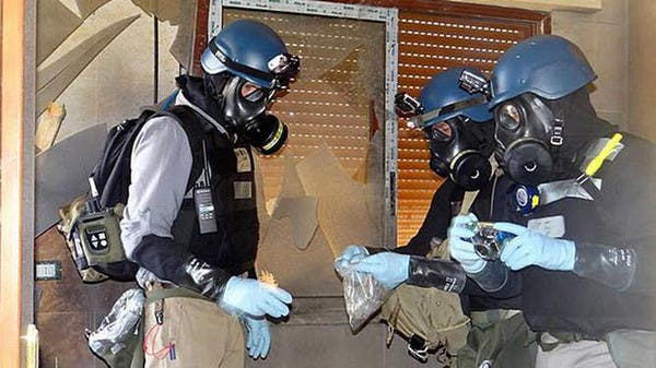 عاملون في منظمة حظر الأسلحة الكيمياوية
