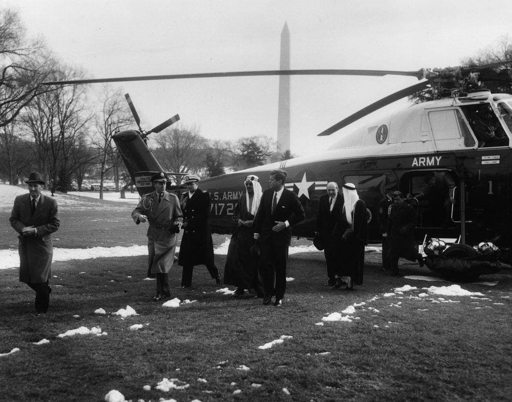 King of Saudi Arabia Saud bin Abdul-Aziz Al Saud and President John F. Kennedy arrive at the White House via United States Army helicopter from Andrews Air Force Base, Maryland on Feb. 13, 1962. (Photographer:Rowe, Abbie. Via: www.jfklibrary.org)