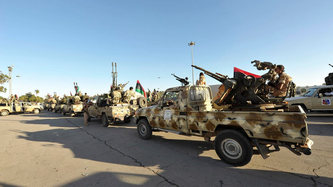 Demonstrators protest against armed militias as they welcome the arrival of the Libyan army in Benghazi, November 8, 2013.