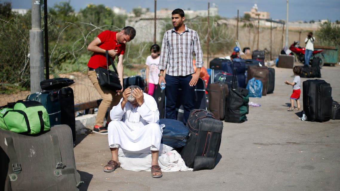Palestinian passengers hoping to cross into Egypt, wait at the Rafah crossing between Egypt and the southern Gaza Strip Sept. 29, 2013. (Reuters)