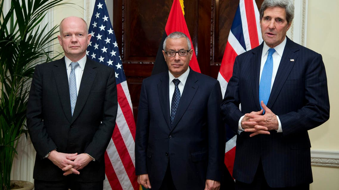 U.S. Secretary of State John Kerry (R) speaks to the media as British Foreign Secretary William Hague (L) and Libyan Prime Minister
