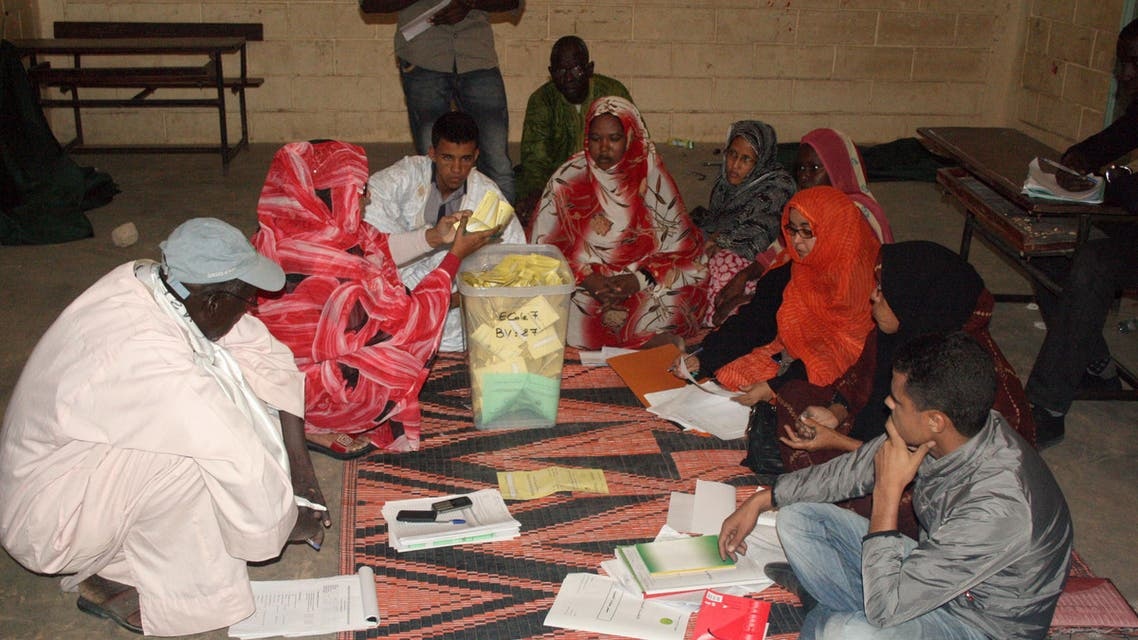 Election workers count ballots late on November 23, 2013 in Nouakchott following nationwide elections. (AFP)