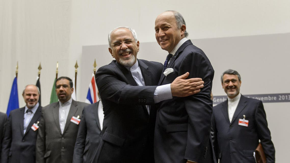 AFP Fabius Zarif hug