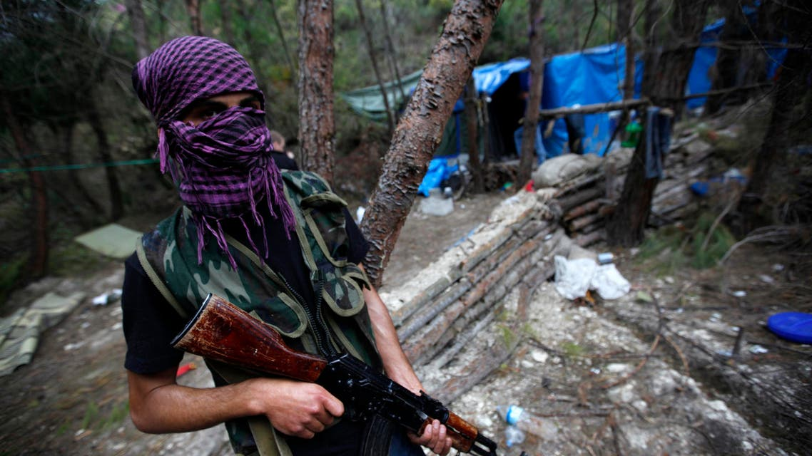 FSA fighter sA Free Syrian Army fighter mans an outpost on the Turkey-Syria border zone near southeast Turkish city of Hatay province April 15, 2012. reuters