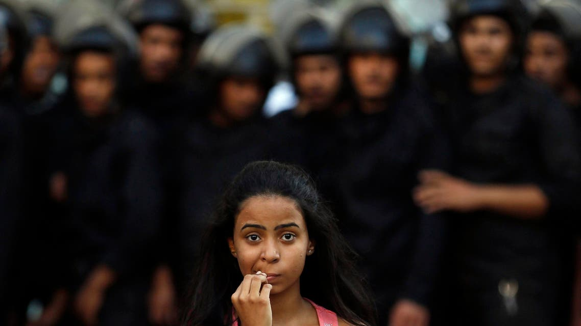 A female activist is pictured in front of riot police during a protest against a new law restricting demonstrations, in downtown Cairo Nov. 26, 2013. (Reuters)