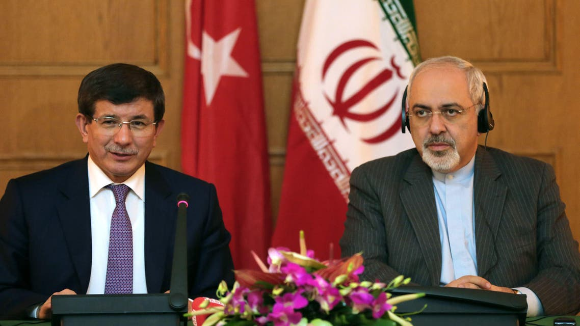 Iranian Foreign Minister Mohammad Javad Zarif (R) gives a joint press conference with his Turkish counterpart Ahmet Davutoglu on Nov. 27, 2013. (Reuters)