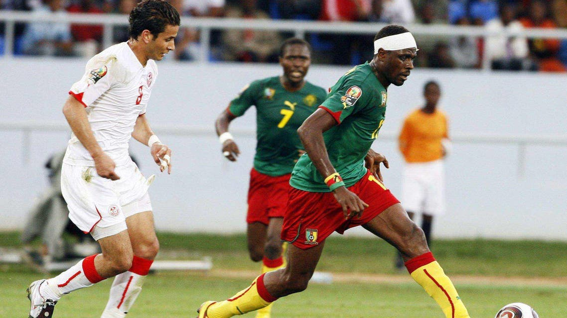 Cameroon striker Benjamin Moukandjo fights for the ball with Tunisian defender Yassine Mikari during their November 17th World Cup qualifier.