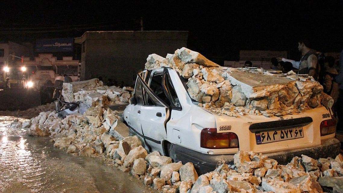 The wreckage of a car amid rubble in the Iranian western city of Borazjan, on Nov. 28, 2013, after a 5.7 magnitude earthquake struck the country. (AFP)