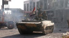 Assad's army kills scores near Damascus