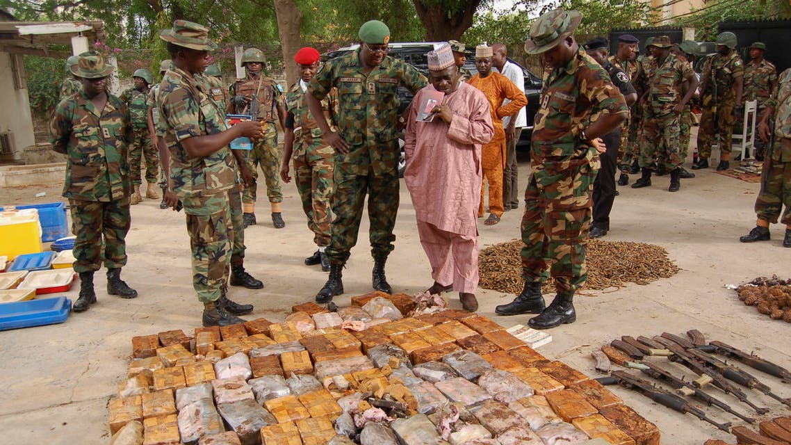 Military officials stand near ammunitions seized from suspected members of Hezbollah after a raid of a building in Nigeria's northern city of Kano May 30, 2013.  (Reuters)