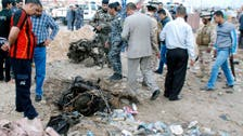 18 bodies found in echoes of Iraq's sectarian war