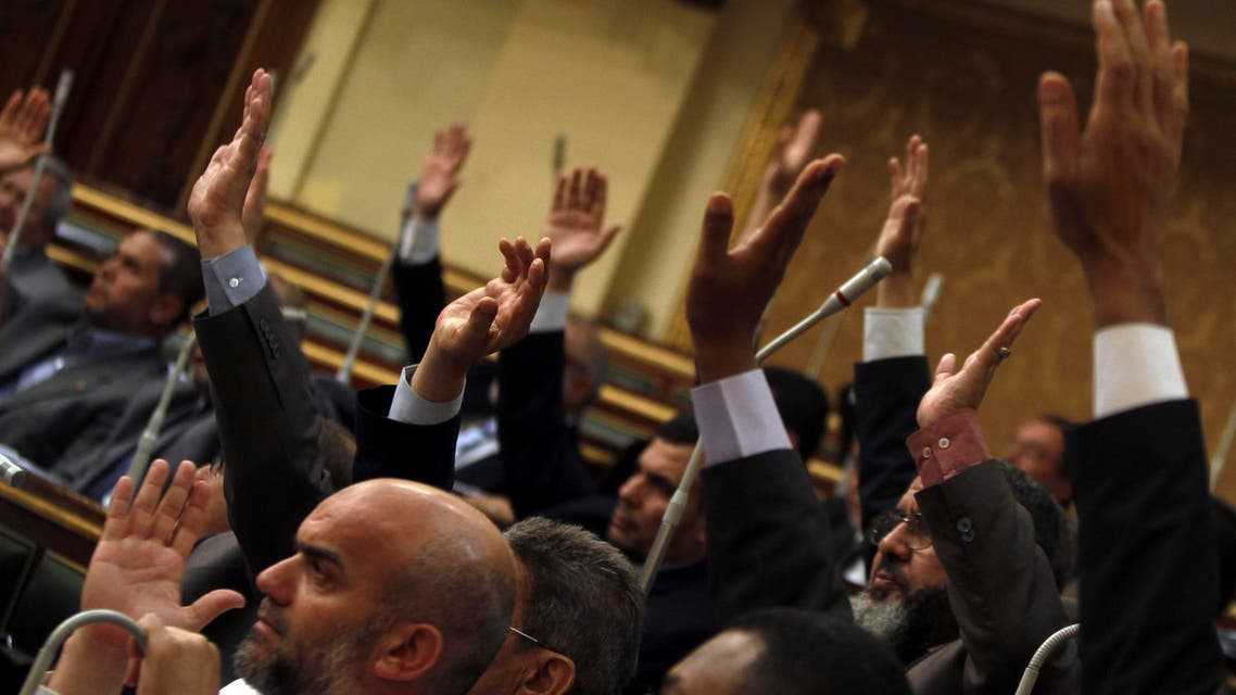 A file photo shows Islamists and members of the Muslim Brotherhood in the Shura Council, raise their hands to approve a law earlier this year. (File photo: Reuters)