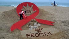Suu Kyi urges 'freedom from fear' on World Aids Day