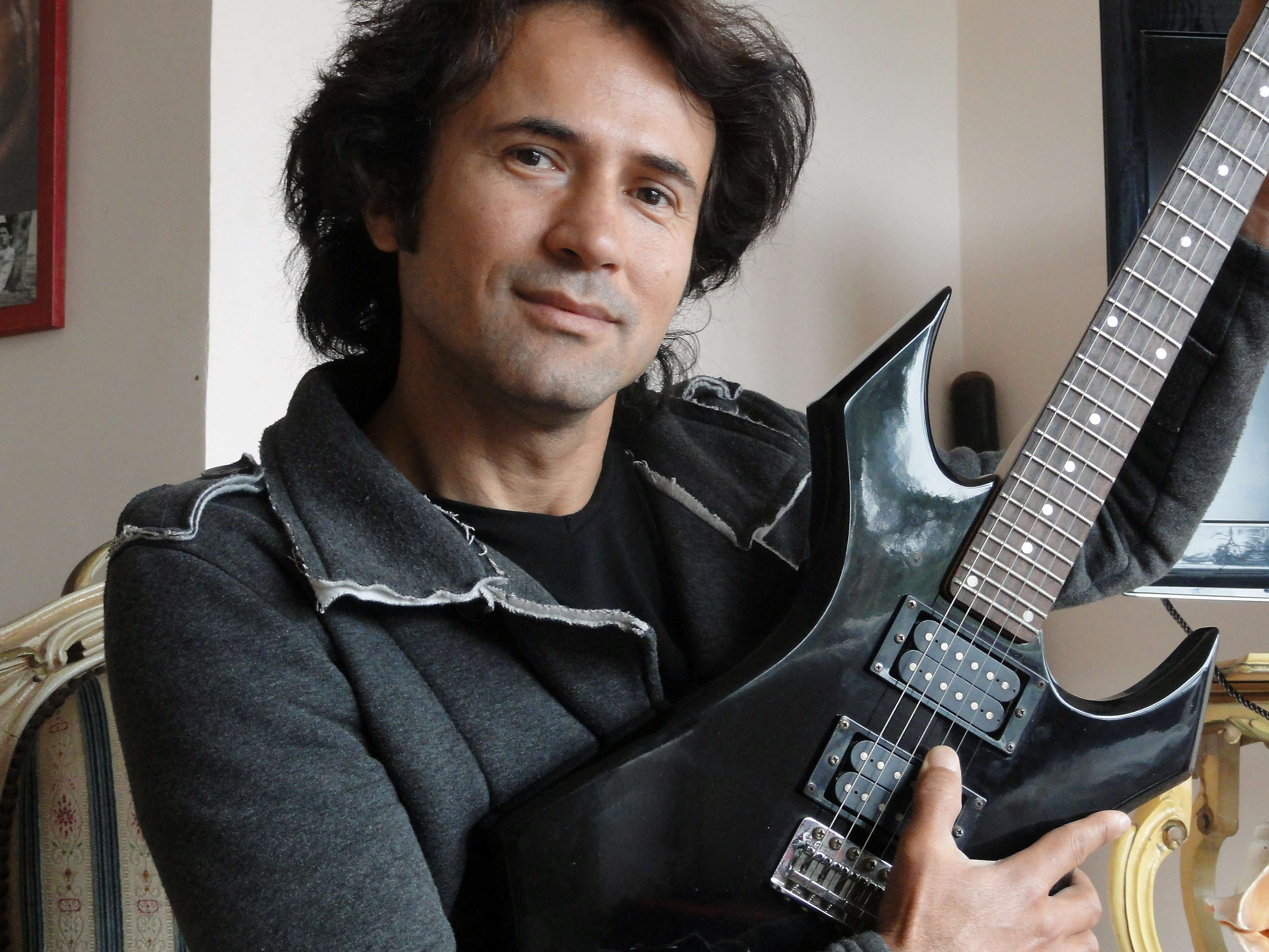 he imam from a tiny hamlet on Turkey's Mediterranean coast has run into trouble with the country's powerful religious authorities -- for his other life as a rock musician .