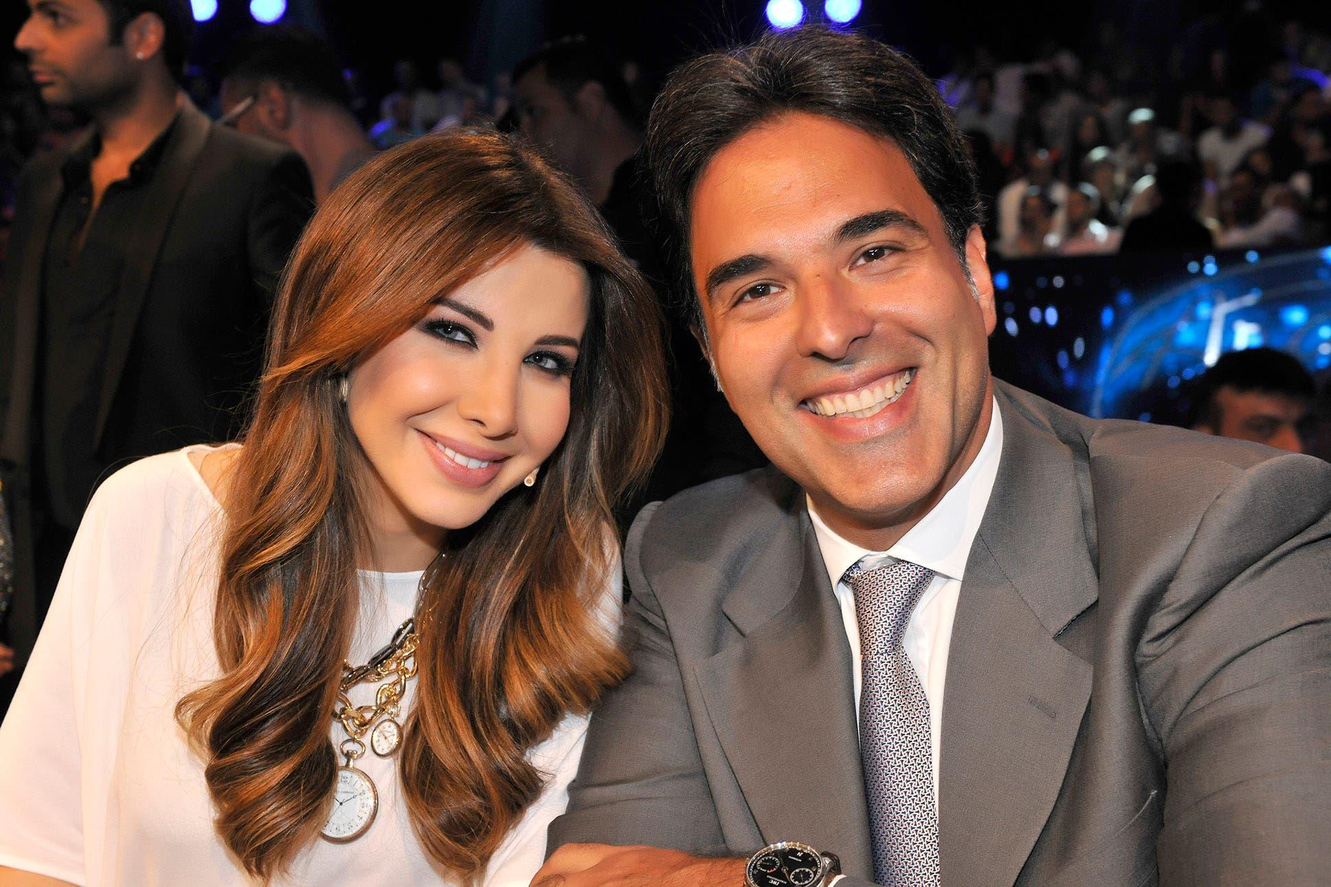 Mazen Hayek with Nancy Ajram on the set of Arab Idol season two