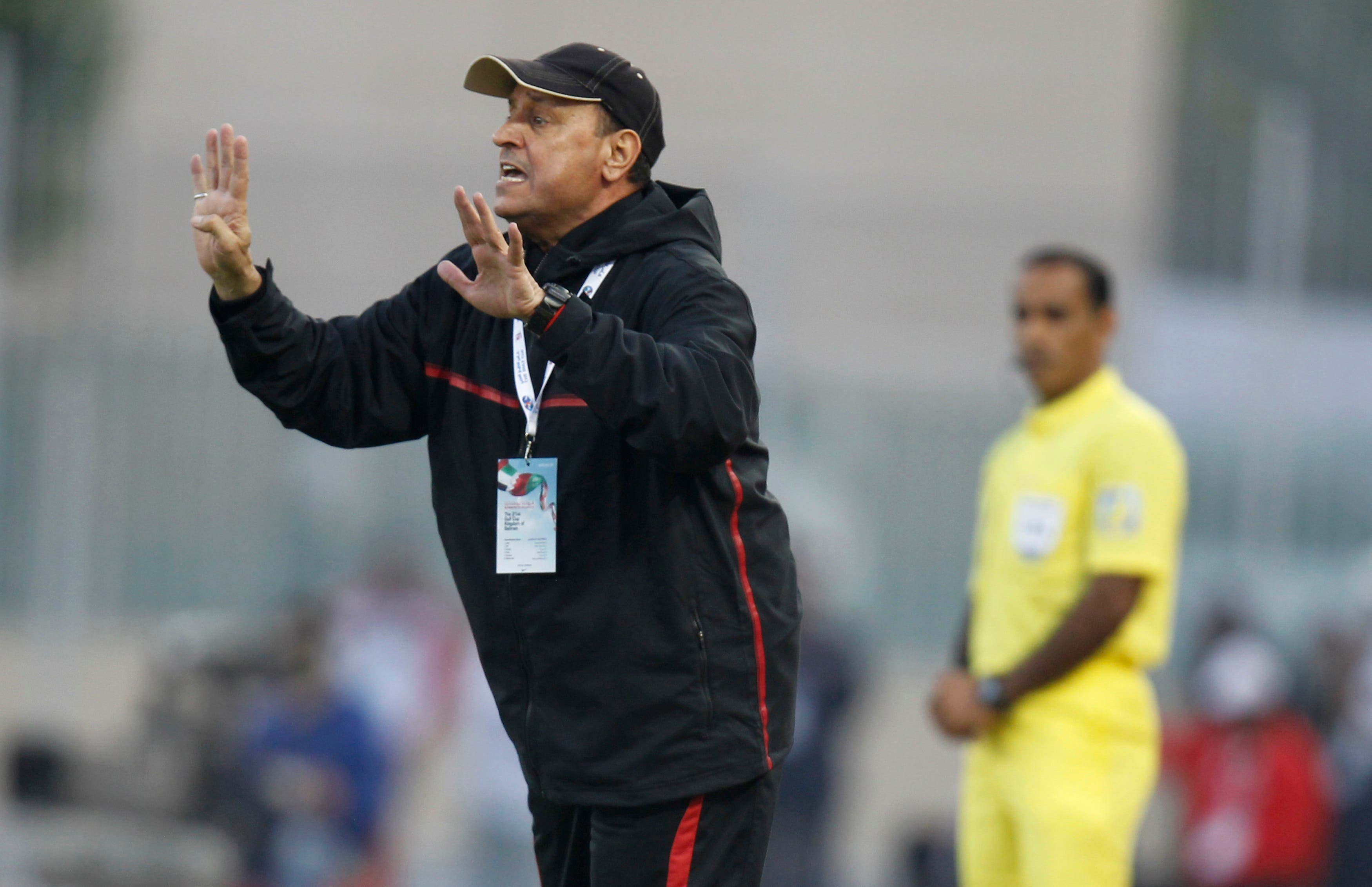 Iraqi's coach Hakim Shaker gestures to his players during their Gulf Cup tournament. (Reuters)