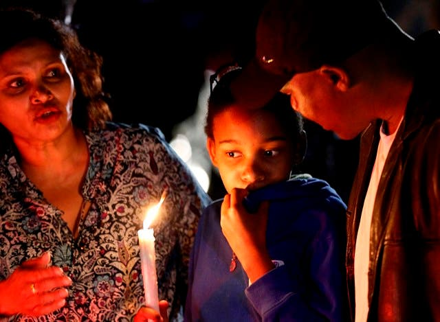 Mourners commemorate the death of Nelson Mandela