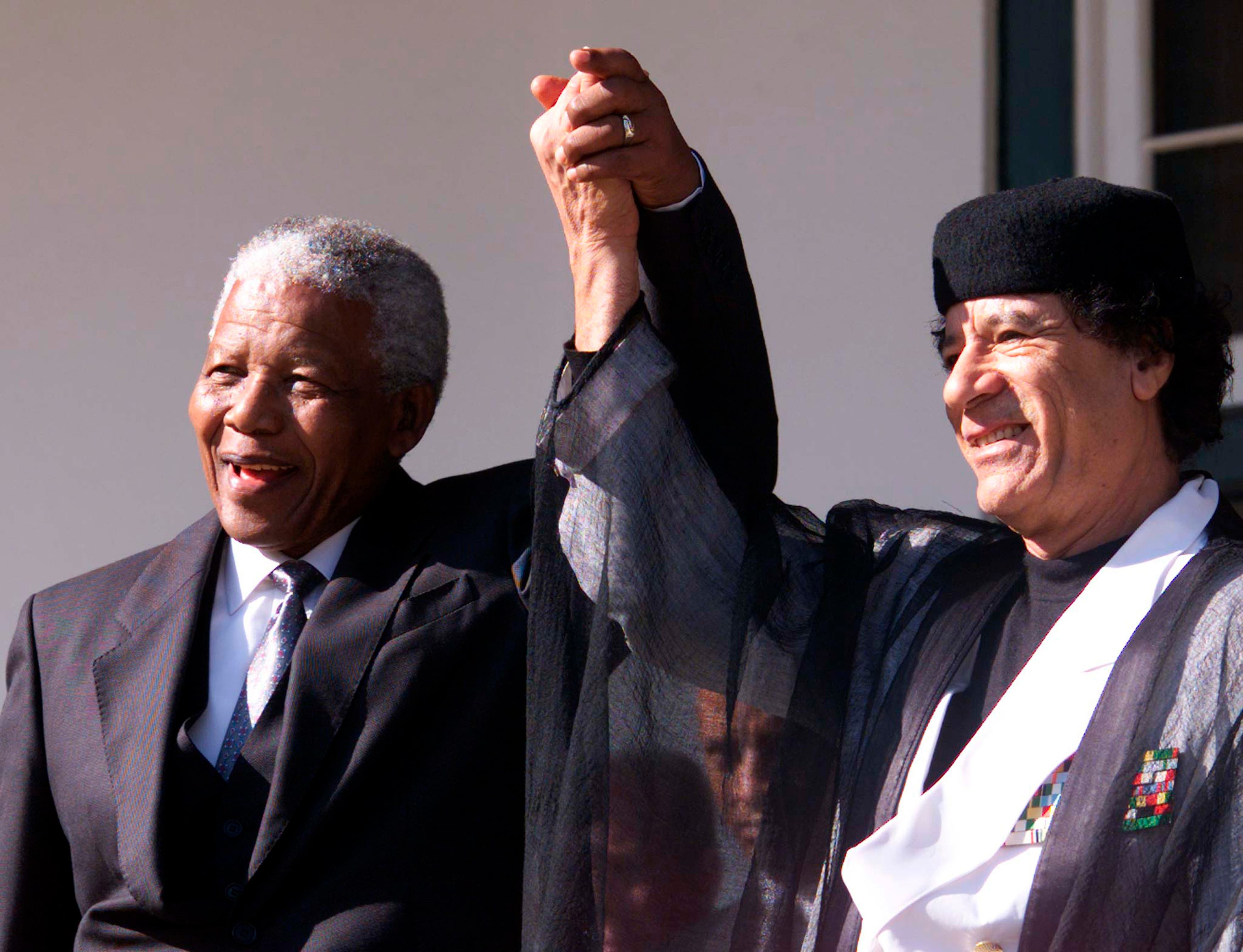 South African President Nelson Mandela and Libyan leader Muammar Qaddafi, pictured here in 1999, were staunch allies. (Reuters)