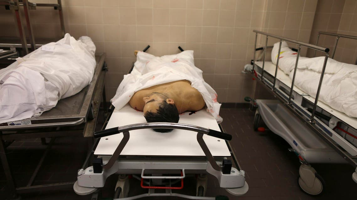 The body of Ronnie Smith is pictured in the morgue at Benghazi Medical Center in Benghazi December 5, 2013. Gunmen shot dead Smith, an American chemistry teacher working at an international school in the Libyan city of Benghazi, medical and security sources said on Thursday. (Reuters)
