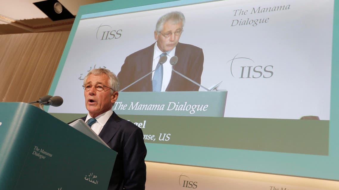 U.S. Defense Secretary Chuck Hagel speaks at the IISS Regional Security Summit - The Manama Dialogue, in Manama, December 7, 2013.