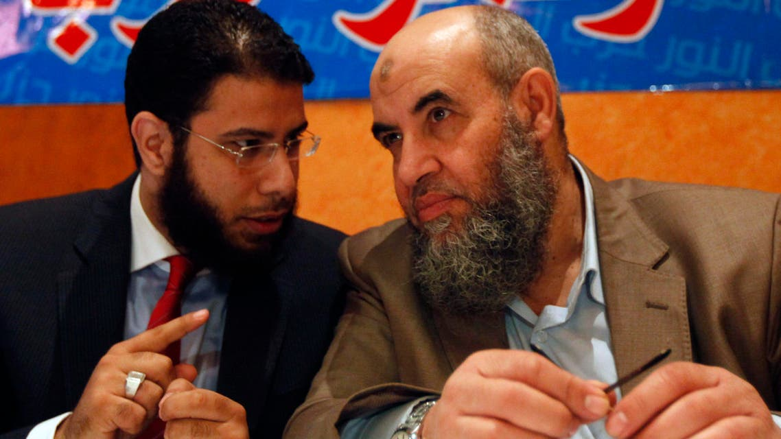Younes Makhyoun (R), the head of the Nour party, listens to party spokesman Nader Bakkar during a news conference about constitution in Cairo Dec. 5, 2013. (Reuters)