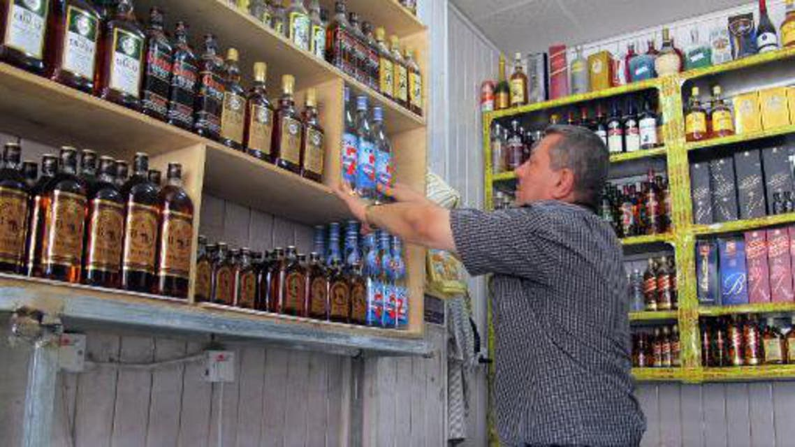 A shopkeeper arranges bottles in a shop in the Zayouna area of the Iraqi capital Baghdad, on May 15, 2013