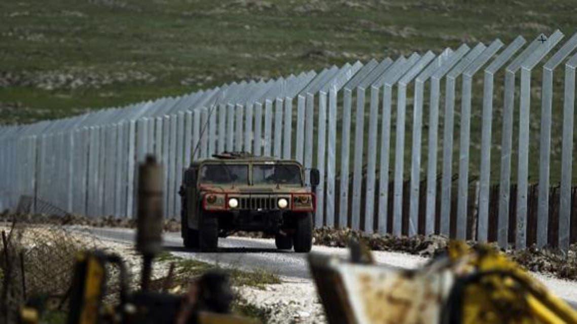 دورية اسرائيلية بالقرب من السياج الفاصل مع سوريا في الجولان