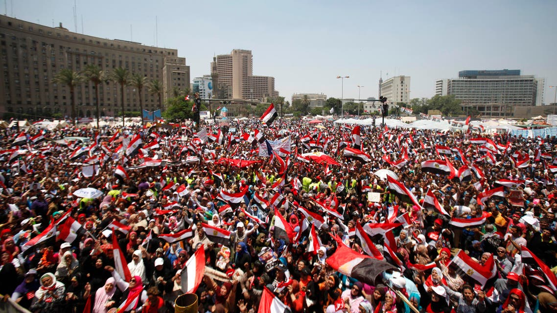 Protesters opposing Egyptian President Mohamed Mursi shout slogans against him and brotherhood members during a protest at Tahrir square in Cairo, June 30, 2013.  File photo: Reuters)