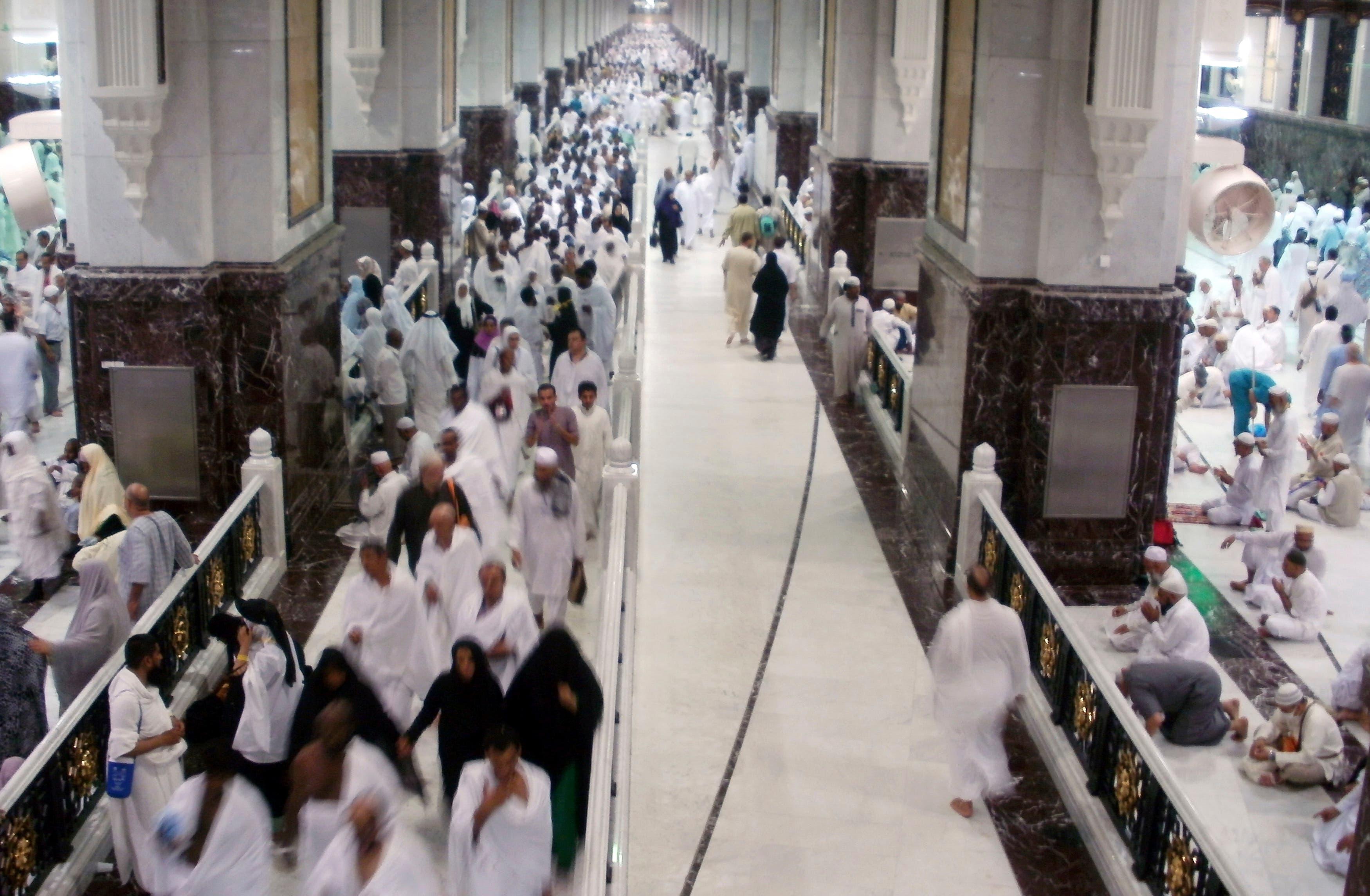 Muslim pilgrims walk at Al-Safa and Al-Marwah (Safa and Marwah) where Muslims walk back and forth seven times during the ritual pilgrimages of Haj and Umrah at the Grand Mosque, during the annual haj pilgrimage in Mecca October 17, 2012. (Reuters)