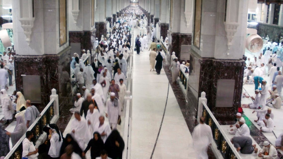 Muslim pilgrims walk at Al-Safa and Al-Marwah (Safa and Marwah) where Muslims walk back and forth seven times during the ritual pilgrimages of Haj and Umrah at the Grand Mosque, during the annual haj pilgrimage in Mecca October 17, 2012. (Reuters)