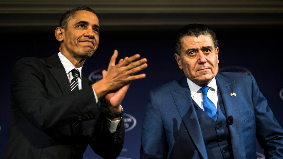 U.S. President Barack Obama (L) arrives to speak with Israeli-American media tycoon Haim Saban about negotiations with Iran in Washington December 7, 2013. (Reuters)