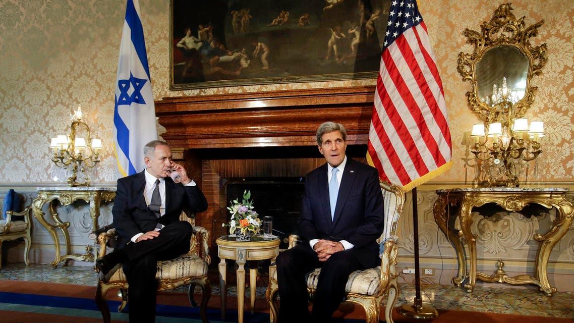 U.S. Secretary of State John Kerry (R) poses with Israeli Prime Minister Benjamin Netanyahu at Villa Taverna in Rome October 23, 2013. reuters